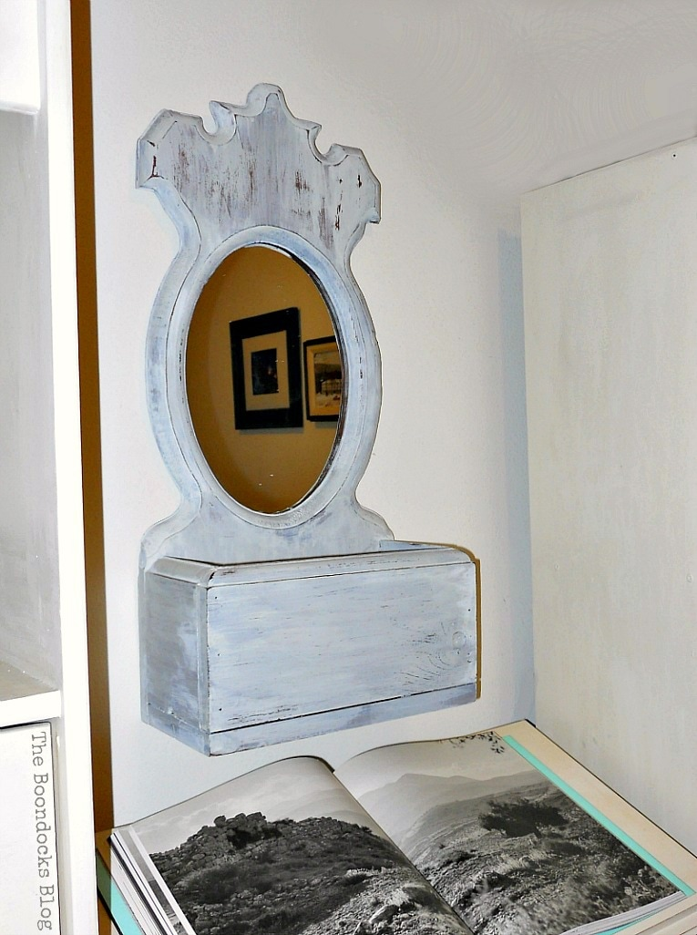 Finished mirror above the dictionary stand, Mirror Makeover with Old Fashioned Milk Paint. www.theboondocksblog.com