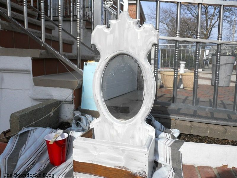 After the first coat of Oyster White Old Fashioned Milk Paint, Mirror Makeover with Old Fashioned Milk Paint. www.theboondocksblog.com