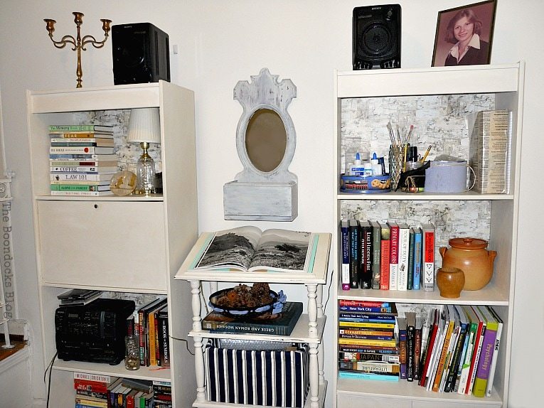 Mirror and dictionary stand flanked by two bookcases with lots of books, Mirror Makeover with Old Fashioned Milk Paint. www.theboondocksblog.com