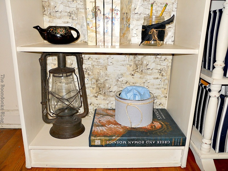 vintage gas lamp, Bookcases Upcycled with Paint and Wrapping Paper www.theboondocksblog.com