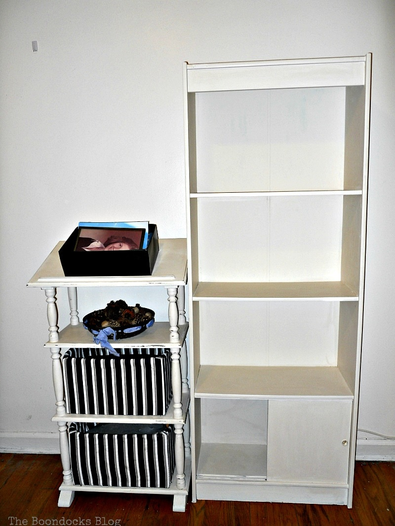 painted bookcase next to stand, Bookcases Upcycled with Paint and Wrapping Paper www.theboondocksblog.com