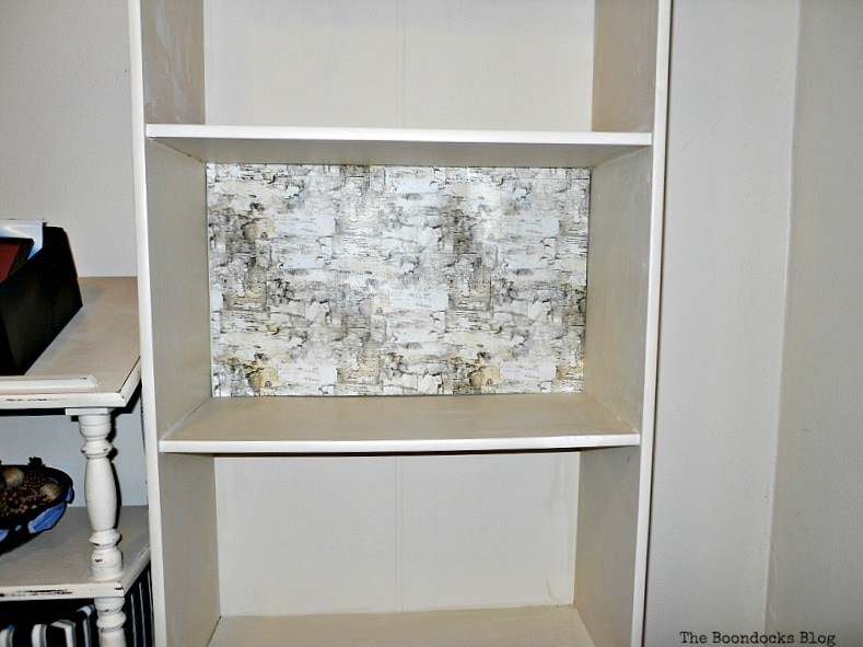 adding a birch background Bookcases Upcycled with Paint and Wrapping Paper www.theboondocksblog.com