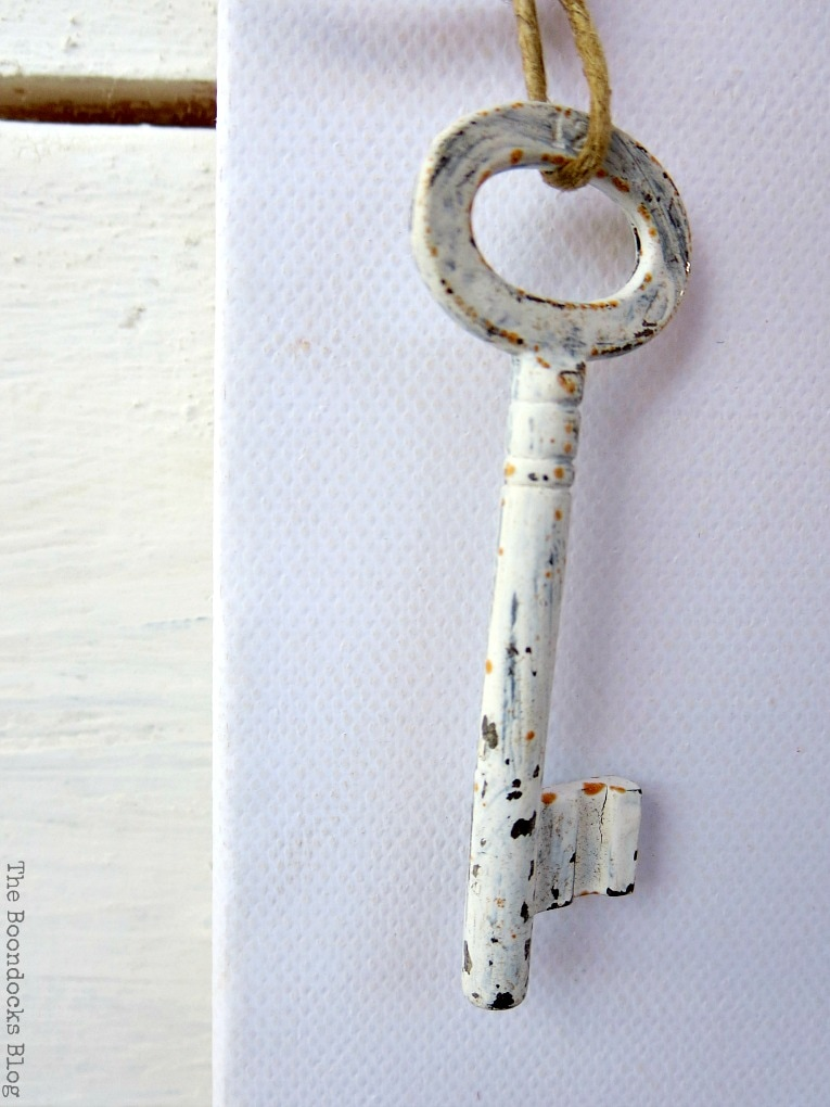 cool chalky painted key full of rust and patina, How to Make Simple Canvas Wall Art with Keys, www.theboondocksblog.com