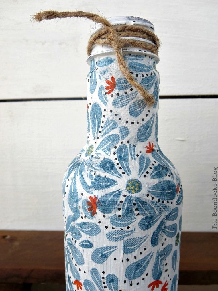 White decoupaged bottle.