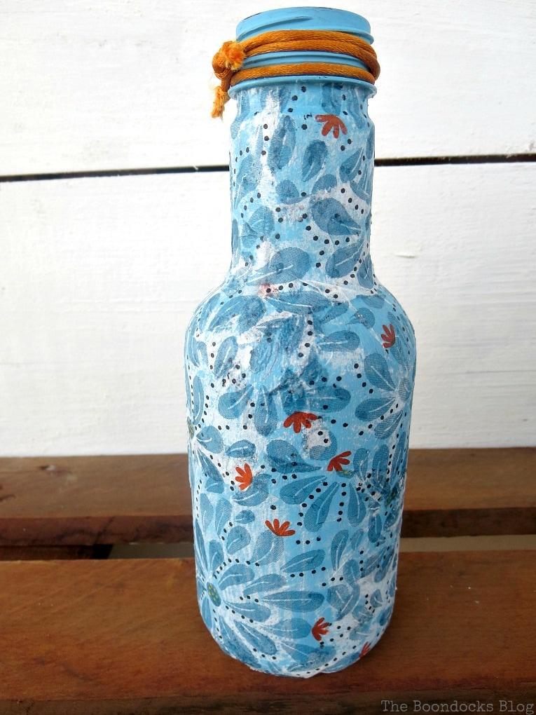 Blue decoupaged bottle.
