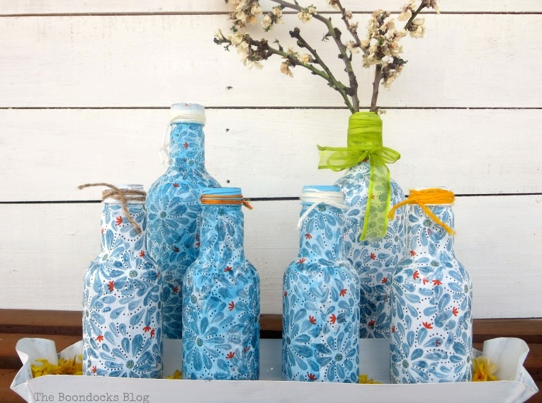 Finished decoupaged bottles,