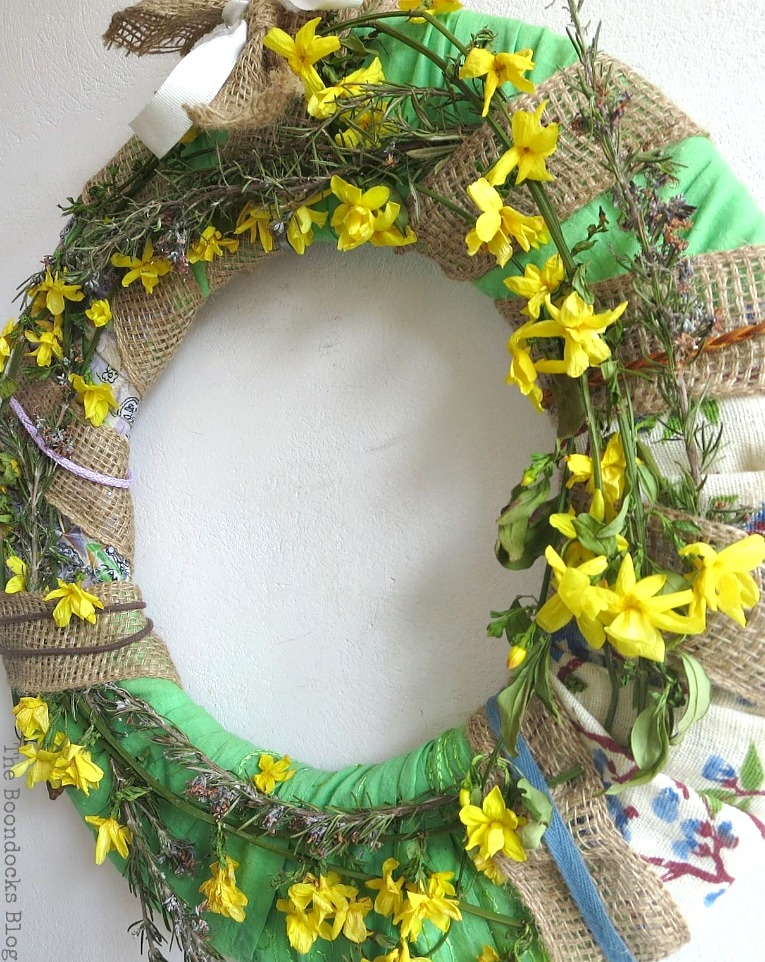 spring wreath with yellow and lavender flowers, How to Make a Green Wreath for Spring www.theboondocksblog.com