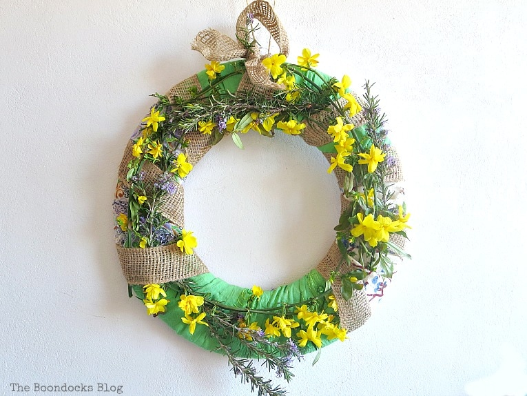 the flowers have been added, How to Make a Green Wreath for Spring www.theboondocksblog.com