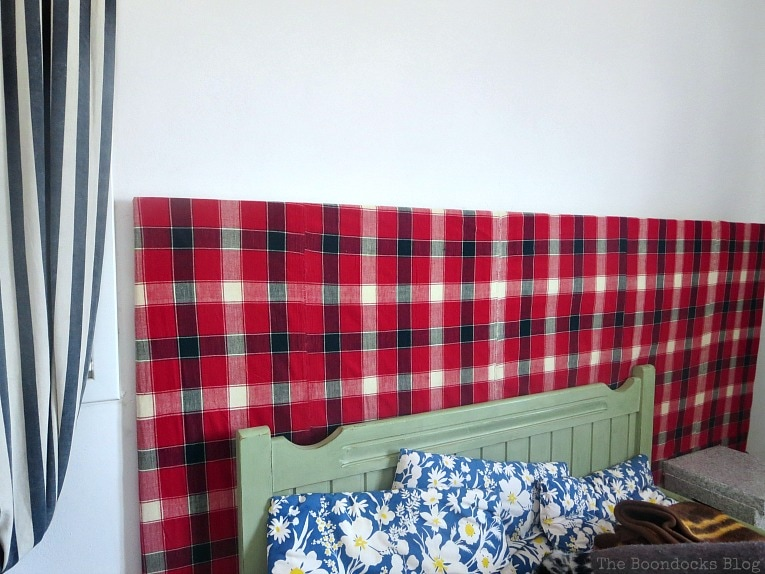 The room with the painted bedframe, How to Easily Warm up a Room with Fabric www.theboondocksblog.com