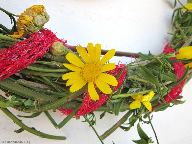 detail of yellow daisy, How To make May Day Wreaths with Recycled Materials www.theboondocksblog.com