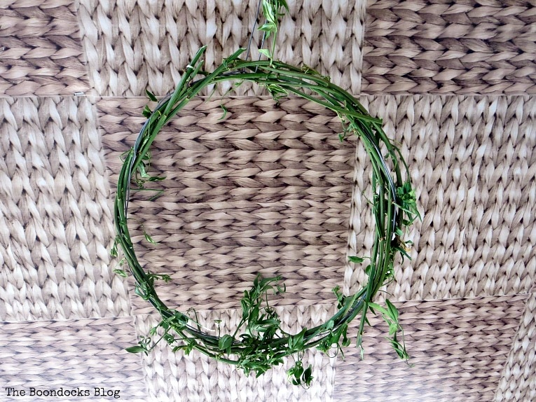 vines wrapped around the wire, How To make May Day Wreaths with Recycled Materials www.theboondocksblog.com