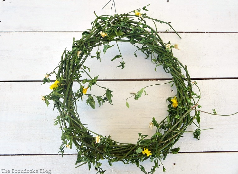 move vines wrapped around the wire, How To make May Day Wreaths with Recycled Materials www.theboondocksblog.com