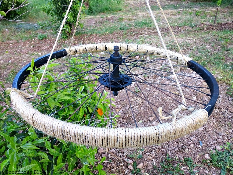 wrapped twine in two areas, How to Re-purpose a tire rim into a Unique wind chime - Int'l Bloggers Club www.theboondocksblog.com