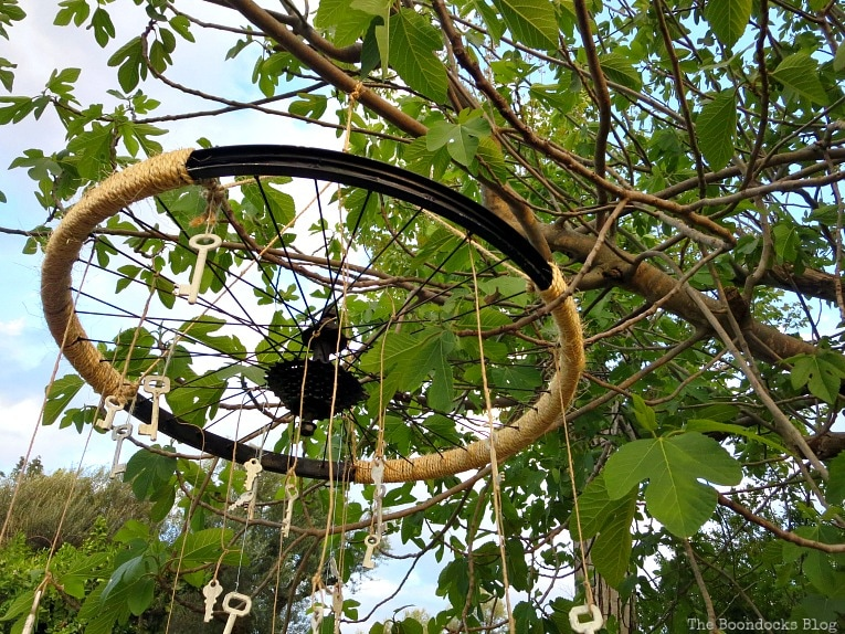a view of the tied keys, How to Re-purpose a tire rim into a Unique wind chime - Int'l Bloggers Club www.theboondocksblog.com