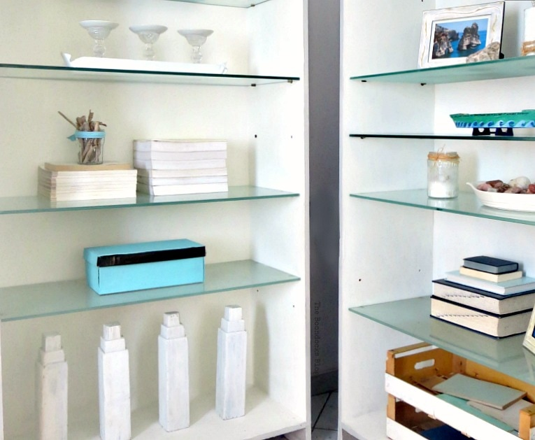 Styled bookcases with blue and white accessories Beachy Nautical style.