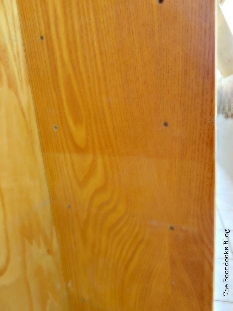 Side of the bookcase with discoloration.