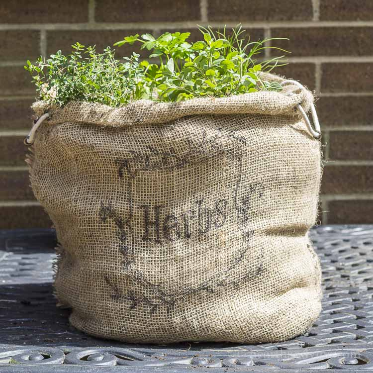 herb garden in a burlap sack, Hearth and Vine, How to Pamper Mom for Mother's Day with DIY Gift Ideas www.theboondocksblog.com