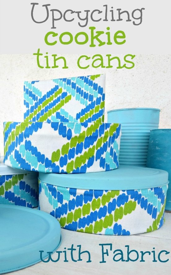 Want to make your cookie tin cans pretty? Upcycle them with fabric and paint.fabric #upcycledtincans #tincanmakeover #cookietincans #prettyfabric #modpodge #Fabriccoveredtincans #newlookforoldthings #DIY How to make pretty cookie tin cans with fabric - IBC www.theboondocksblog.com