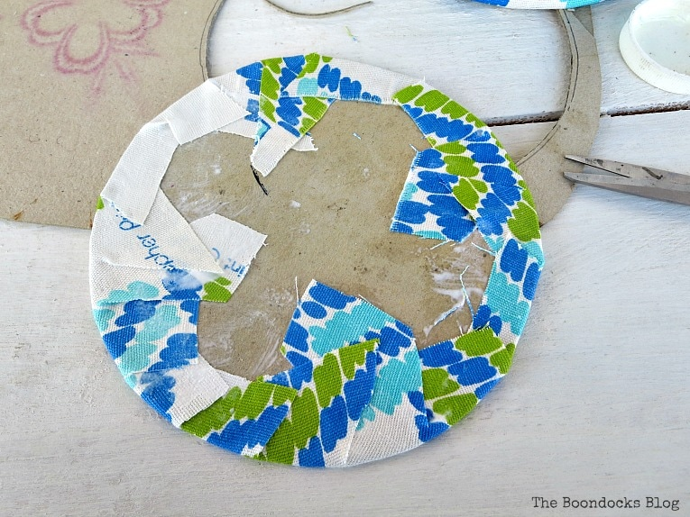 gluing fabric onto cardboard, How to make pretty cookie tin cans with fabric - IBC www.theboondocksblog.com