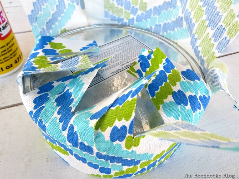the exterior bottom fabric cut into strips, How to make pretty cookie tin cans with fabric - IBC www.theboondocksblog.com