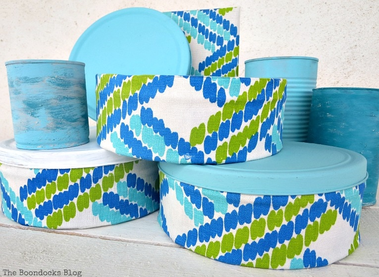 fabric covered tin cans, with painted tin cans, How to make pretty cookie tin cans with fabric - IBC www.theboondocksblog.com