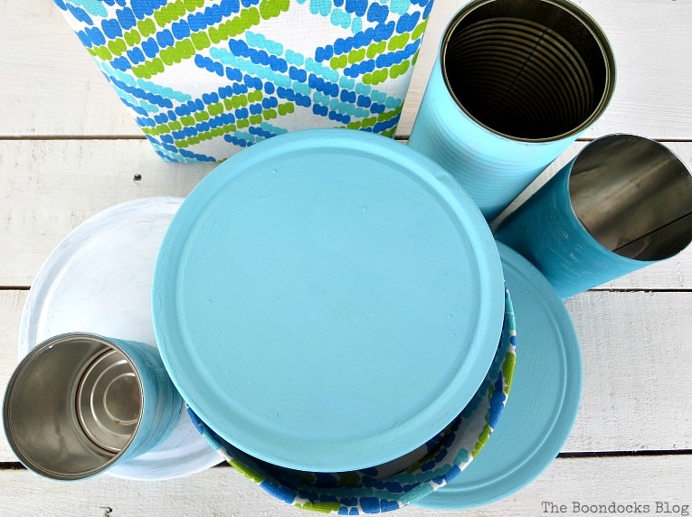 painted tin covers, How to make pretty cookie tin cans with fabric - IBC www.theboondocksblog.com