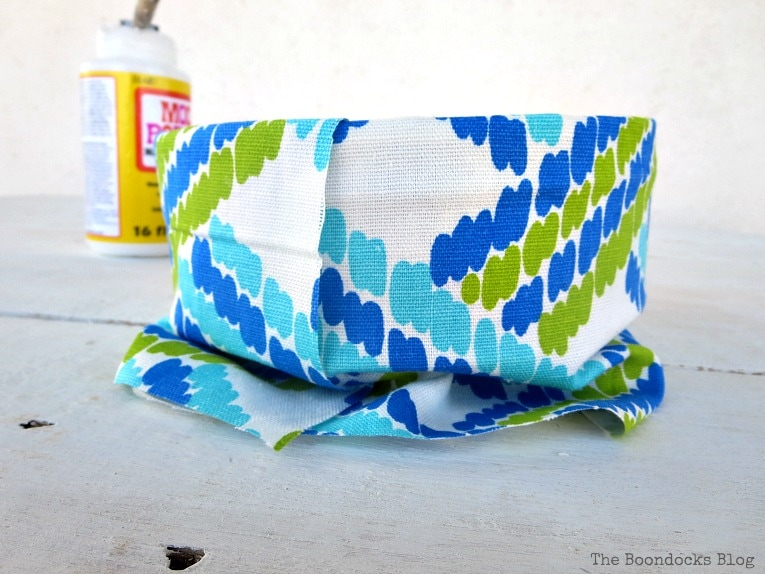 fabric around the exterior, How to make pretty cookie tin cans with fabric - IBC www.theboondocksblog.com