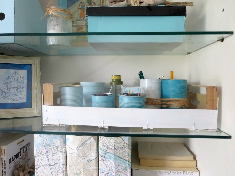tin cans used for organization and storage, Pretty and Practical Bookcases the Easy Way www.theboondocksblog.com