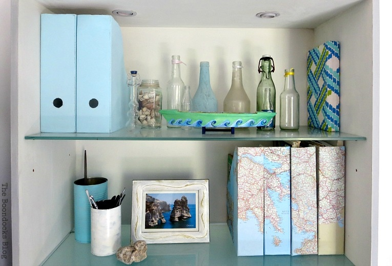 Bookcase two with magazine files and tin cans, Pretty and Practical Bookcases the Easy Way www.theboondocksblog.com