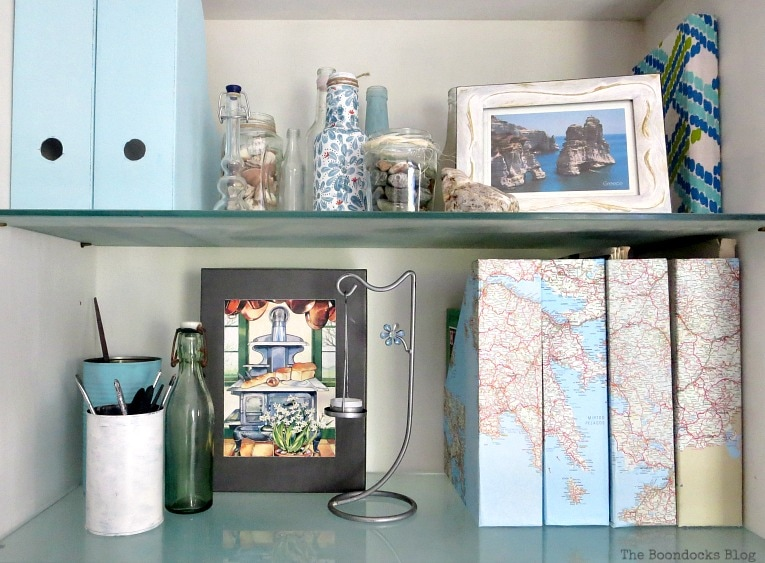A gray box added to the shelf, Pretty and Practical Bookcases the Easy Way www.theboondocksblog.com