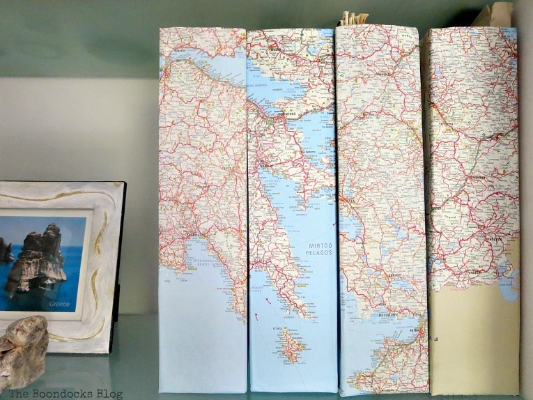 magazine files decoupaged with maps, Pretty and Practical Bookcases the Easy Way www.theboondocksblog.com