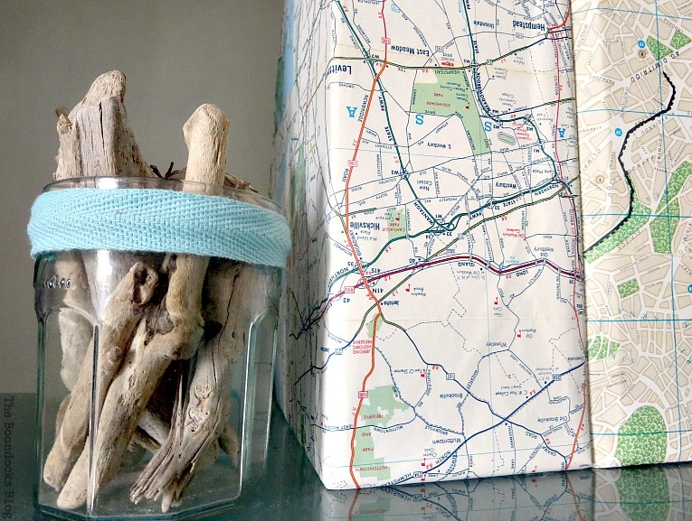map covered magazine files with decoupage, Pretty and Practical Bookcases the Easy Way www.theboondocksblog.com