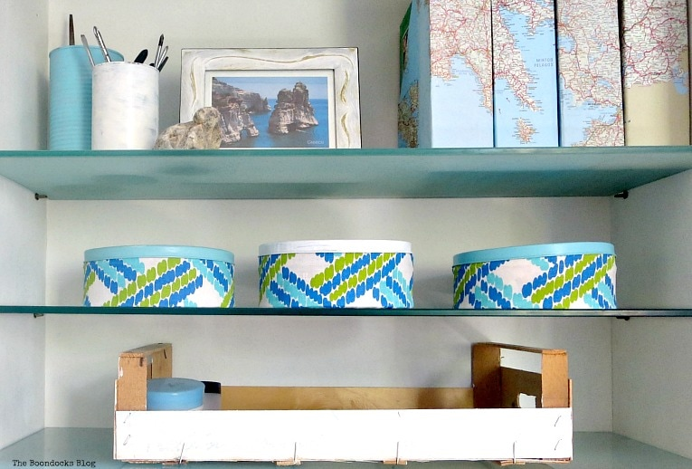 cookie tin cans decoupaged with fabric and a crate, Pretty and Practical Bookcases the Easy Way www.theboondocksblog.com