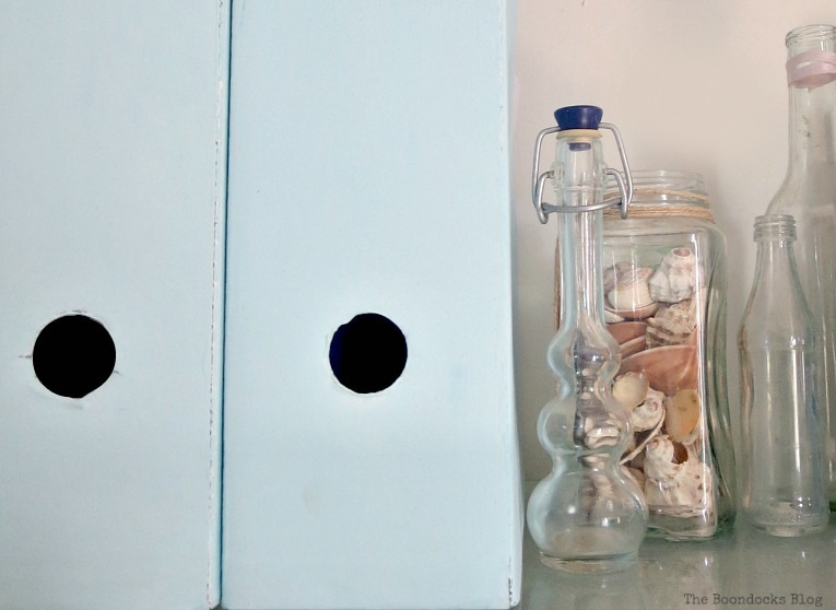 close up of magazine file and bottles with shells, Pretty and Practical Bookcases the Easy Way www.theboondocksblog.com