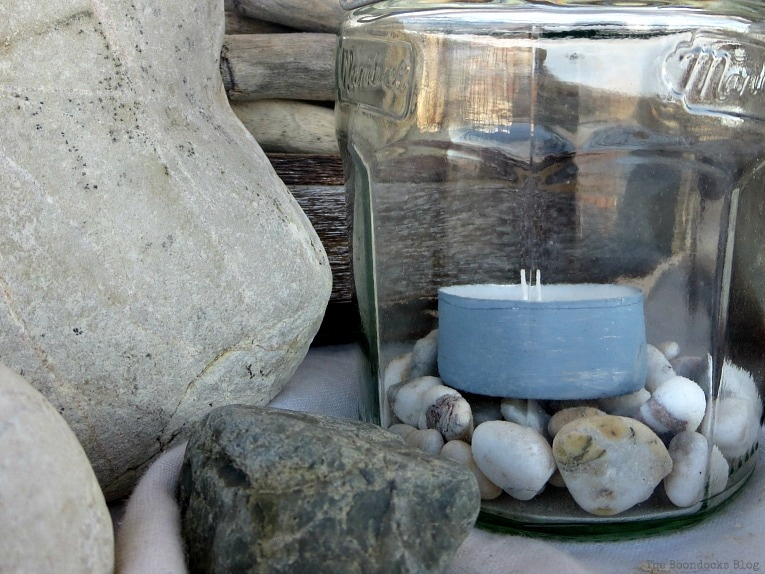 painted tea light inside lantern jar, #easycraft #repurposedjars #tealightlanterns #fastcraft #DIYlanternlights #wireproject How to make Simple Lanterns with Repurposed Jars, www.theboondocksblog.com