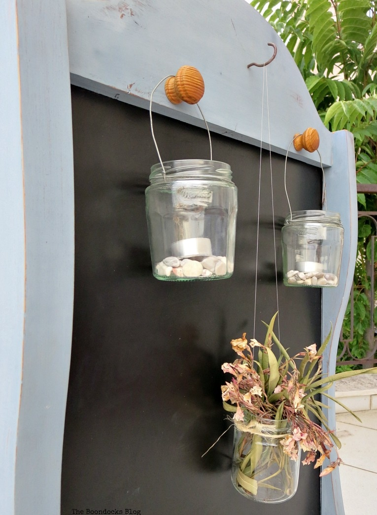 hanging lanterns, How to Give New Life to a Chalkboard Stand www.theboondocksblog.com