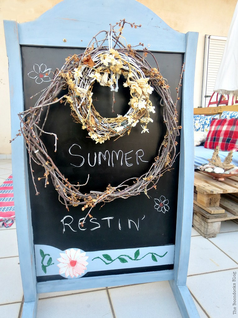 the other side of the standing chalkboard, How to Decorate a Balcony with Re-Purposed Treasures, www.theboondocksblog.com