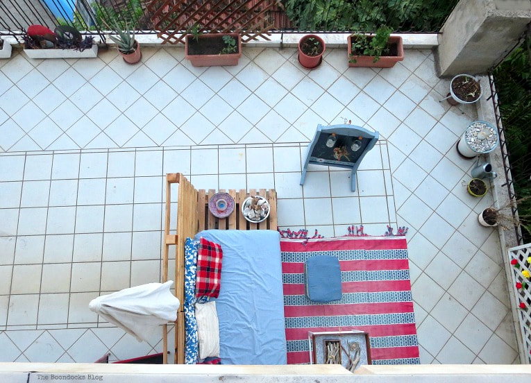 overview of balcony space, How to Decorate a Balcony with Re-Purposed Treasures, www.theboondocksblog.com