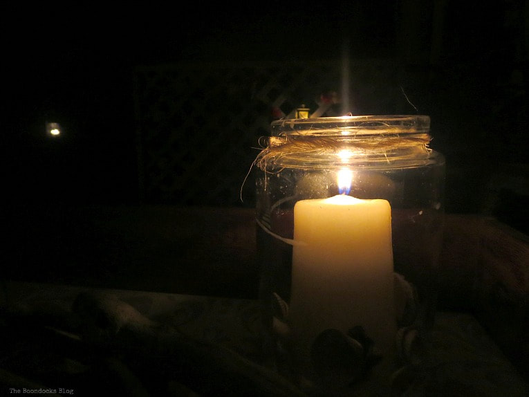 Lit candle inside glass container, How to Decorate a Balcony with Re-Purposed Treasures, www.theboondocksblog.com