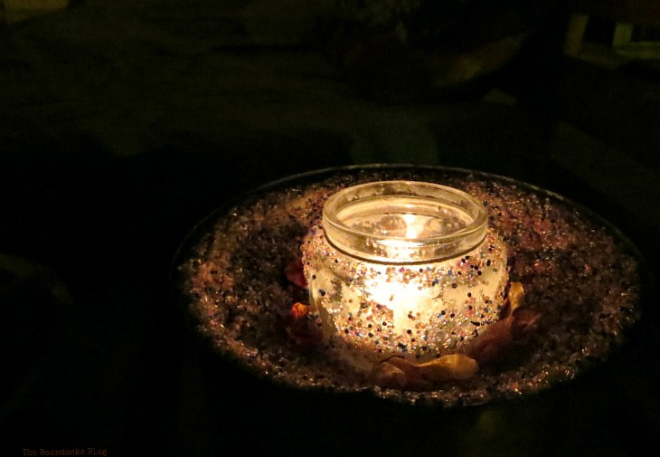 tea light inside glass on top of copper lid, night view, How to Decorate a Balcony with Re-Purposed Treasures, www.theboondocksblog.com