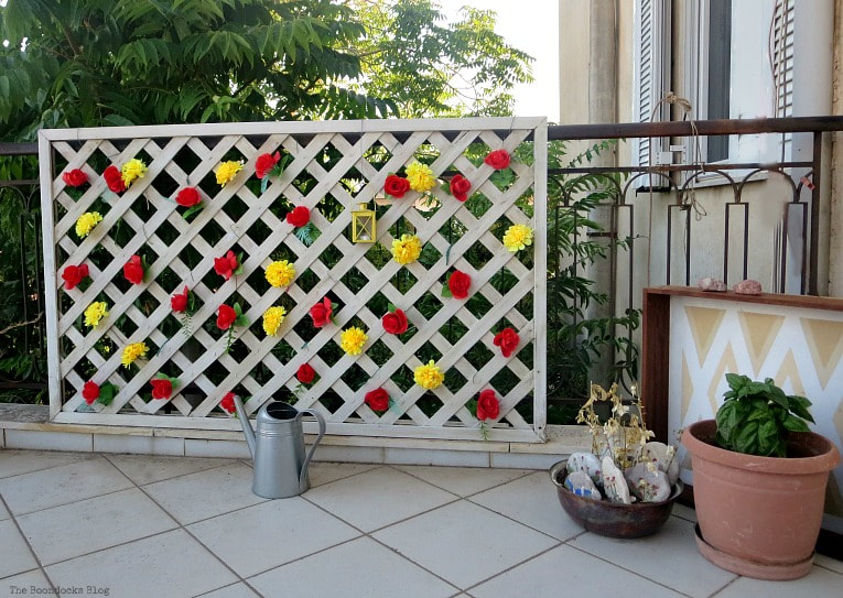 colorful fence, How to Decorate a Balcony with Re-Purposed Treasures, www.theboondocksblog.com