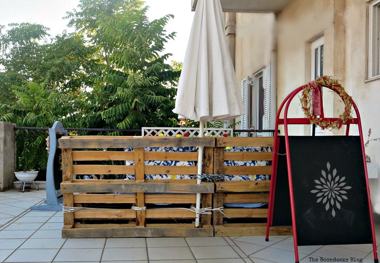 back view of the pallet couch, How to Decorate a Balcony with Re-Purposed Treasures, www.theboondocksblog.com