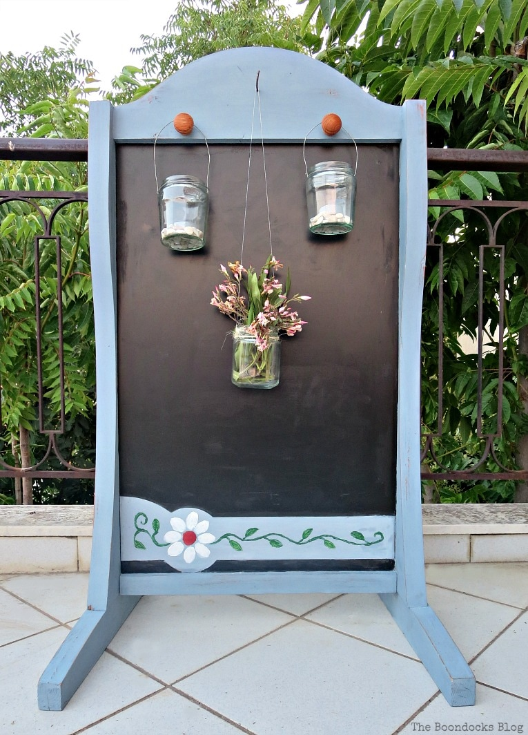 One side with lanterns, How to Give New Life to a Chalkboard Stand www.theboondocksblog.com