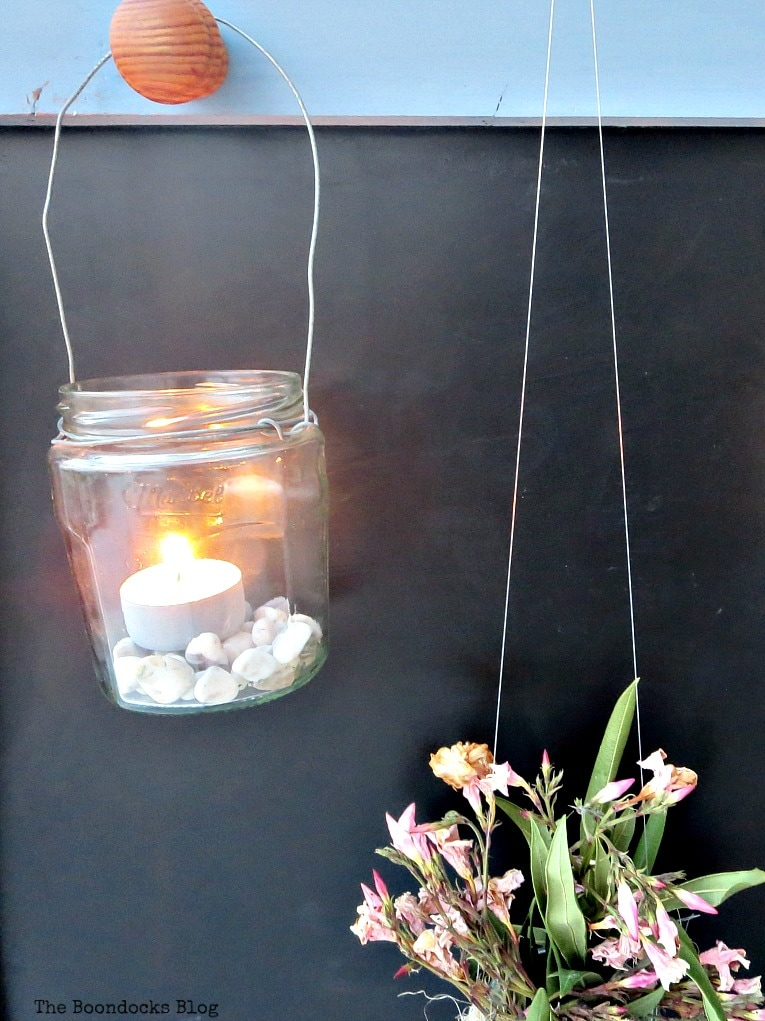 lit tea lights in lantern, How to Give New Life to a Chalkboard Stand www.theboondocksblog.com