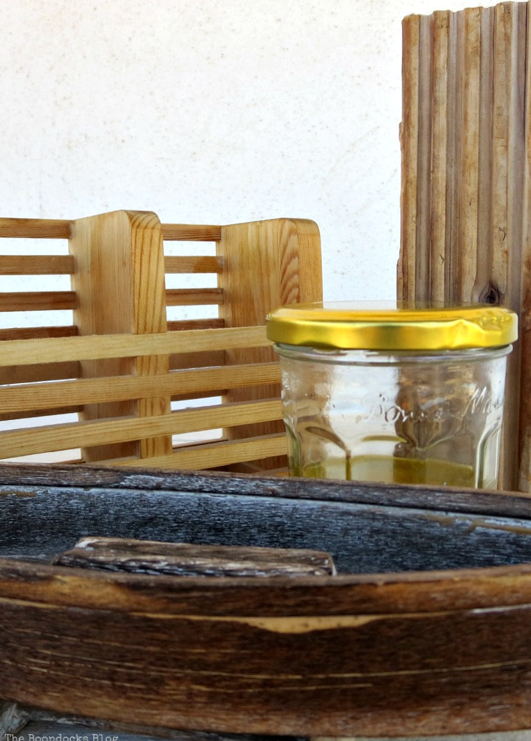 Oil and vinegar mixture in a jar, How to Easily Clean Wood with Just 2 Ingredients www.theboondocksblog.com
