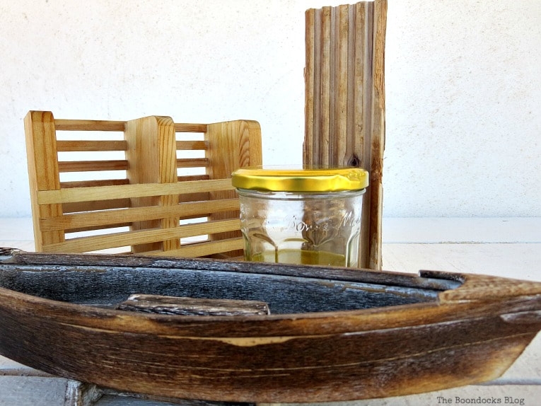 Jar of oil and vinegar mixture and wood pieces, How to Easily Clean Wood with Just 2 Ingredients www.theboondocksblog.com