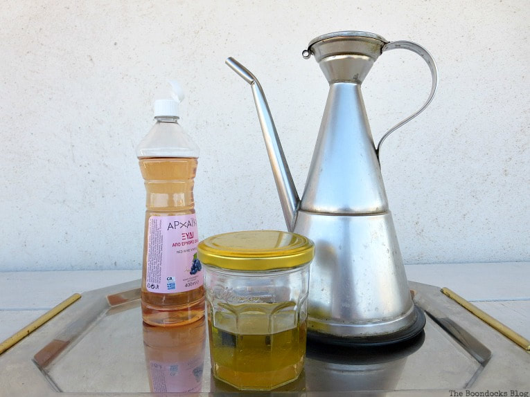 olive oil, vinegar and a jar, How to Easily Clean Wood with Just 2 Ingredients www.theboondocksblog.com