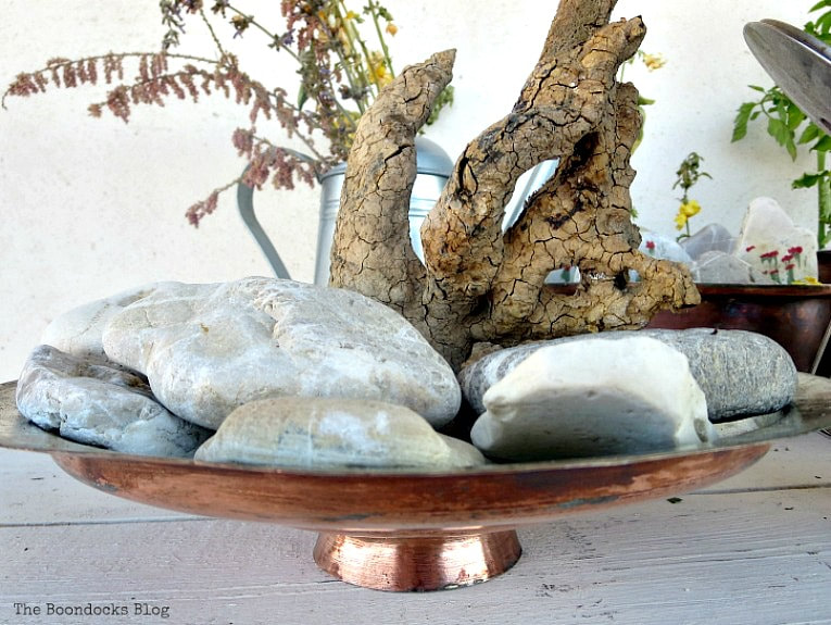 copper lid with rocks and wood stump as abstract art, How to Upcycle Vintage Copper Pots the Wrong Way www.theboondocksblog.com