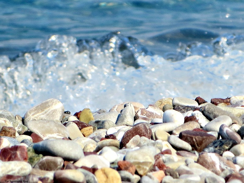 water splashing against the pebbles at the beach, Photo of the Day July 2017 www.theboondocksblog.com