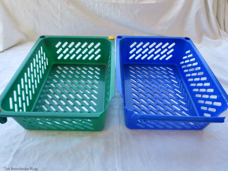 Two broken plastic baskets.